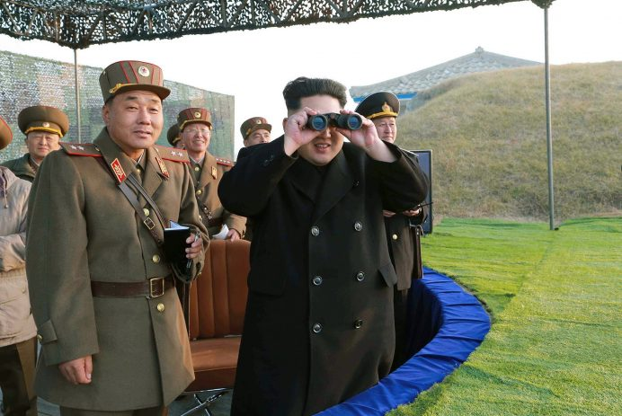 """This undated photo released by North Korea's official Korean Central News Agency (KCNA) on November 23, 2014 shows North Korean leader Kim Jong-Un (C) inspecting a combined joint military drill of the units under North Korean People's Army Combined Units 572 and 630 at an undisclosed location.  Meanwhile, South Korea staged a live-fire military drill on November 21 near its disputed Yellow Sea border with North Korea, despite warnings from Pyongyang ahead of a sensitive anniversary.   -- REPUBLIC OF KOREA OUT --   AFP PHOTO / KCNA via KNS  THIS PICTURE WAS MADE AVAILABLE BY A THIRD PARTY. AFP CAN NOT INDEPENDENTLY VERIFY THE AUTHENTICITY, LOCATION, DATE AND CONTENT OF THIS IMAGE. THIS PHOTO IS DISTRIBUTED EXACTLY AS RECEIVED BY AFP. ---EDITORS NOTE---  RESTRICTED TO EDITORIAL USE - MANDATORY CREDIT """"AFP PHOTO / KCNA VIA KNS"""" - NO MARKETING NO ADVERTISING CAMPAIGNS - DISTRIBUTED AS A SERVICE TO CLIENTS"""